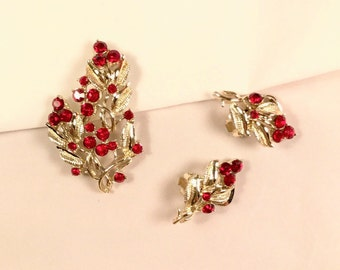 Vintage Demi Earrings and Brooch.  A light gold tone setting & Red Rhinestone flowers. Brooch 2 1/4 inches tall, Earrings 1 1/4 inches tall