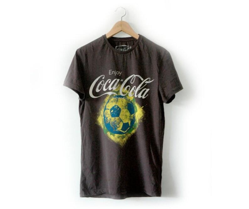 0be05bb24 Cocoa Cola football tee   Etsy