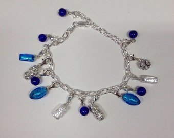 Charm bracelets: Silver bracelets with glass charms.