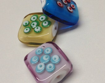 Planets: rectangular shaped Murano glass pendants.  3 colors.