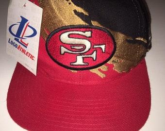 8c00dba29 Vintage 90 s San Francisco 49ers NFL Football Logo Athletic Splash Snapback  Hat Cap Deadstock