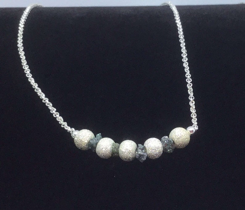 Green diamond and sterling silver Stardust necklace.
