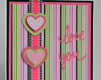 "Handmade bright and happy ""LOVE YOU"" Valentine's Day card with pinks, greens, accent black, layered diecut hearts, ribbon"