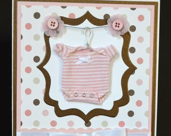 Handmade Adorable welcome Baby Girl Card  5x7  miniature pink onesie on hanger white bow designer pink & brown paper, pink buttons, wire