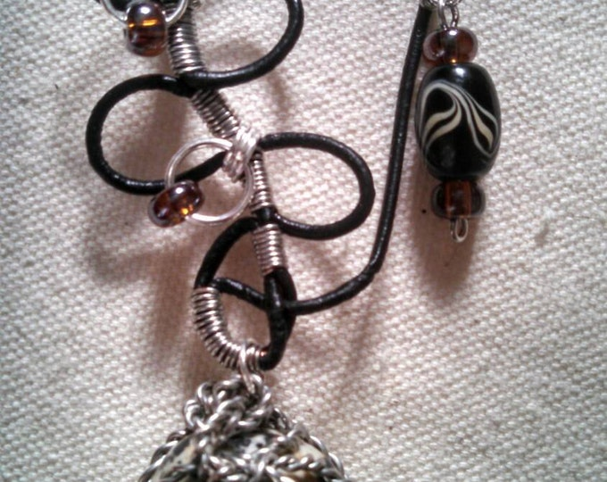 Featured listing image: Black leather, silver hand twisted wire, and Dalmatian jasper stone necklace.