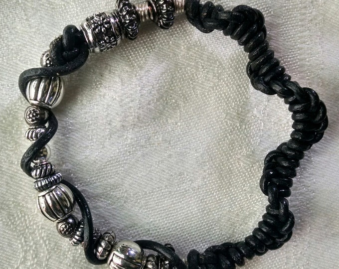 Featured listing image: Black leather and silver bracelet.