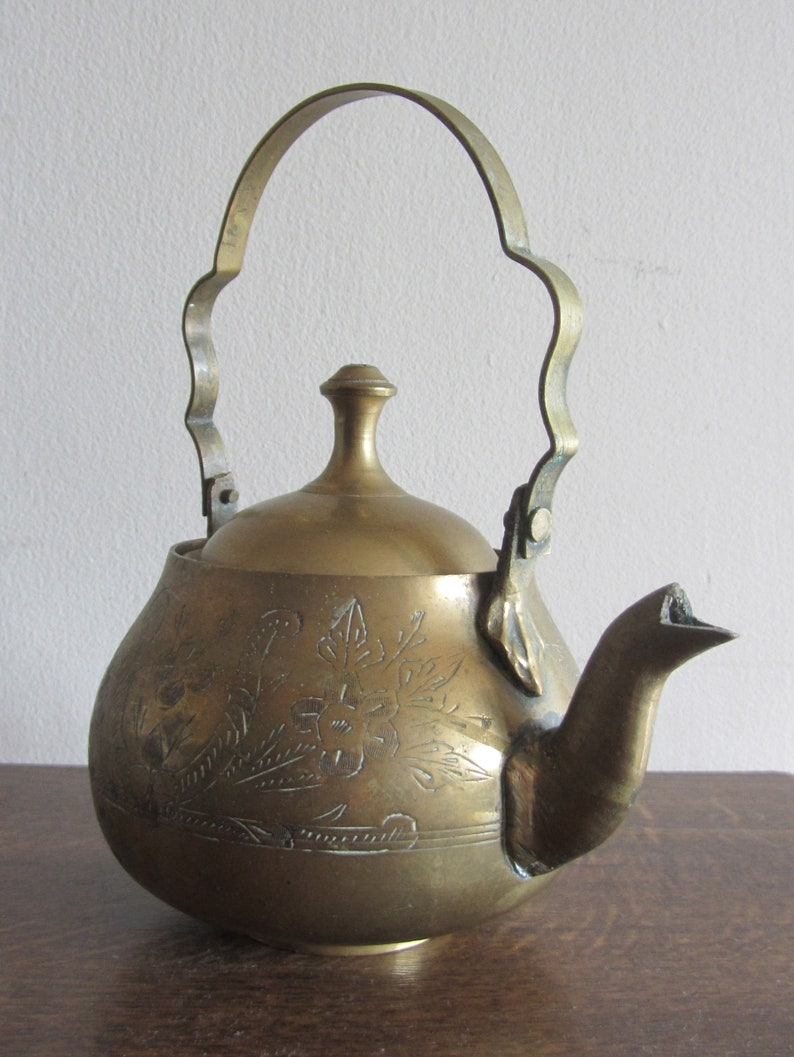 Vintage brass teapot with lid housewarming gift for everyone. Classic shape small tea pot decorative engraved metal handled lidded kettle