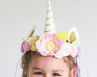 Unicorn crown headpiece in pretty pastels with felt flowers, gold glitter and ribbons. Optional flower wand and glitter vial accessories.