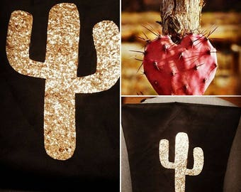 Pillows with black and gold cactus
