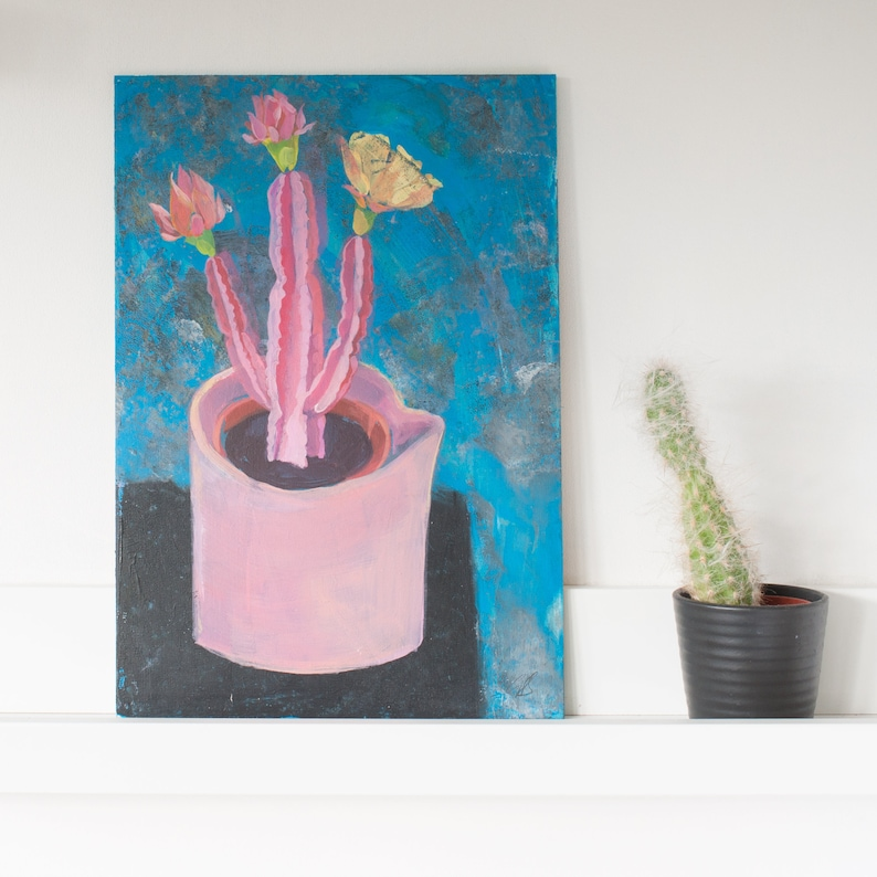 A pink cactus in a pink ceramic pot an unframed still life image 0