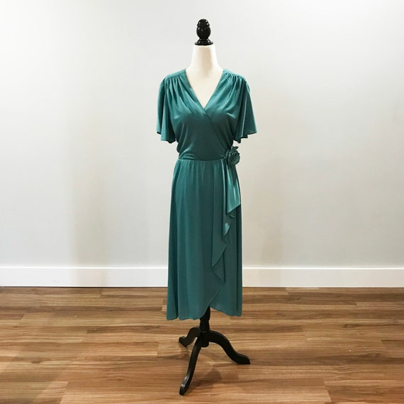 1970s wrap front dress in soft green