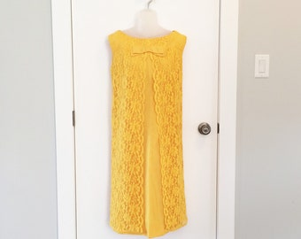 Mod 1960s dress in mustard yellow lace with bow detail
