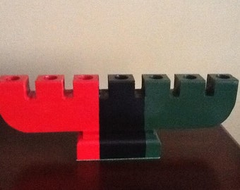 Red, Black and Green Wooden  Kinara for Kwanzaa.  55th Anniversary 2021