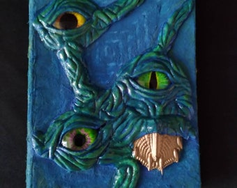 Creepy blue green Monster with eyes mini tome sketchbook with natural fiber pages upcycled painted sculpture bizarro pet