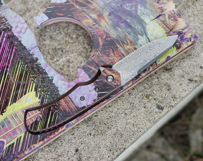Unique knife with recycled handle from #SKATEBOARD