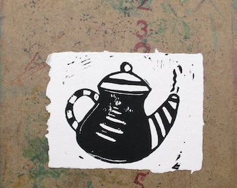 Teapot block print on pink recycled paper