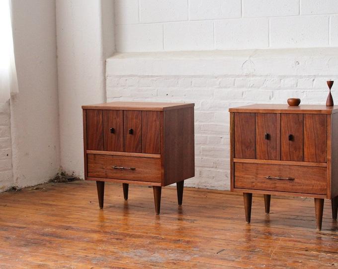 Pair of Double Door Walnut Nightstands with Ebonized Tabs