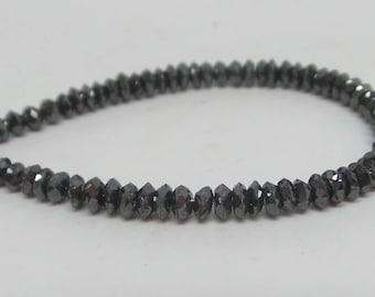 Great quality faceted saucer shaped natural black diamond beads. 1.7 mm to 3.1 mm. 4 inch strand. 9.3 carat. DB75