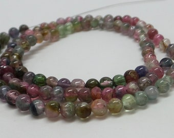 Multicolor natural smooth watermelon tourmaline round beads. 3.5 mm to 3.9 mm. 14 inches long. SPS1952