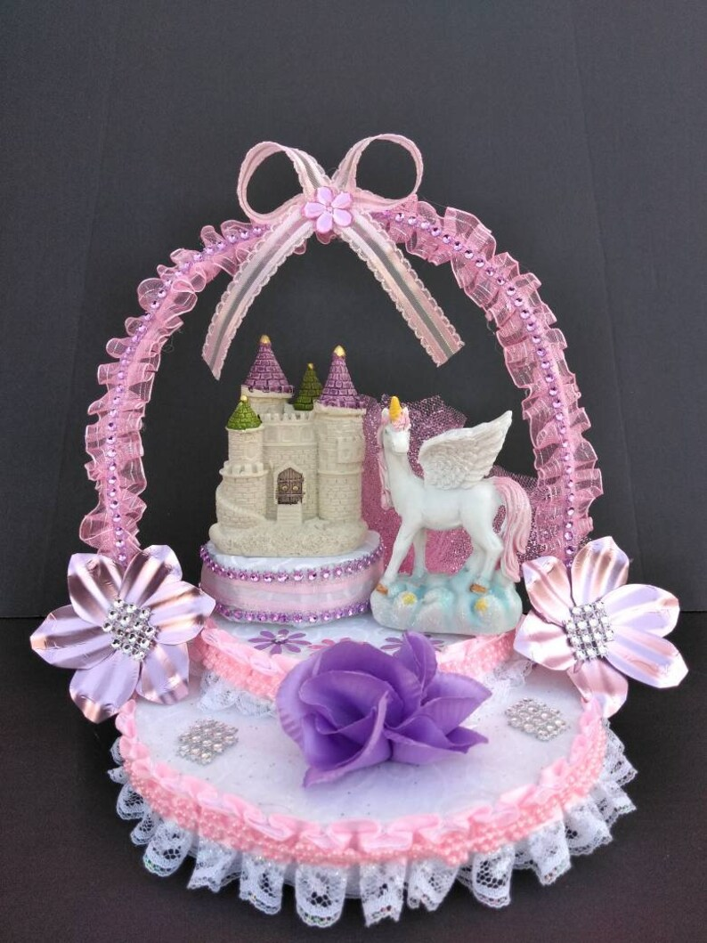 Beautiful original baby girl unicorn birthday cake topper party celebration  pink table centerpiece decoration.