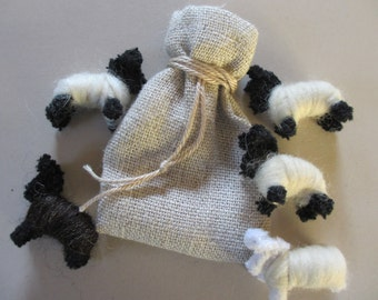 Worry sharing sheep in a natural Linen draw string bag