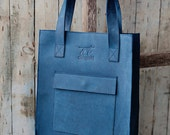 Blue leather tote bag with front pocket