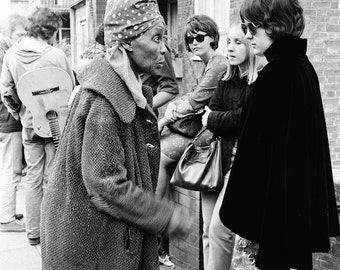 Portobello Road market, London England, Beatles era, black and white photograph, hippie era, swinging 60s, Notting Hill, vintage photo.