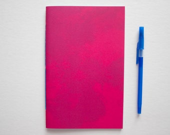 Pink Watercolor Notebook with Blue Pages