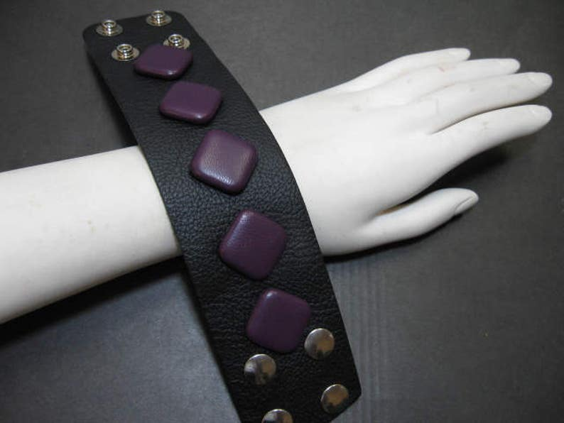 Unique Leather Wristband with Snap Closure in Black with Purple Leather Covered Buttons