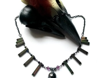 Rainbow - dyed hematite gothic rock chick unusual necklace with a skull