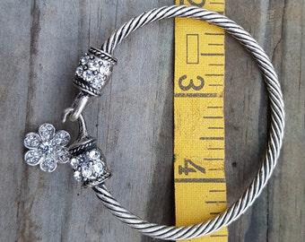 Silver Tone Rhinestone Bangle Bracelet With a Flower Charm