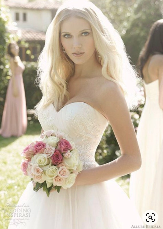 Ivory tulle on champagne, strapless ball wedding g