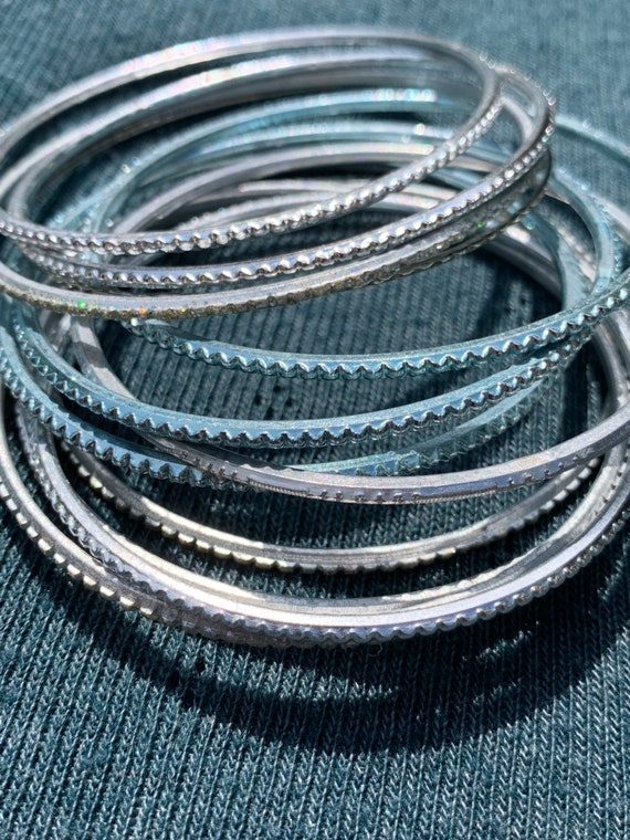 Collection of blue and silver metal indian bangles to fit a large girls wrist