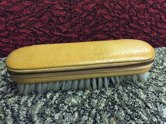 Vintage clothes brush with fawn leather zipped compartment on top