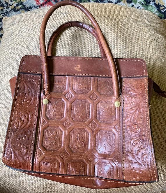 Vintage stiff brown leather bag