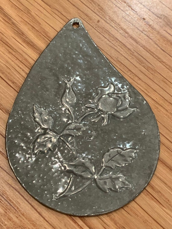 Enamel on metal rose pendant