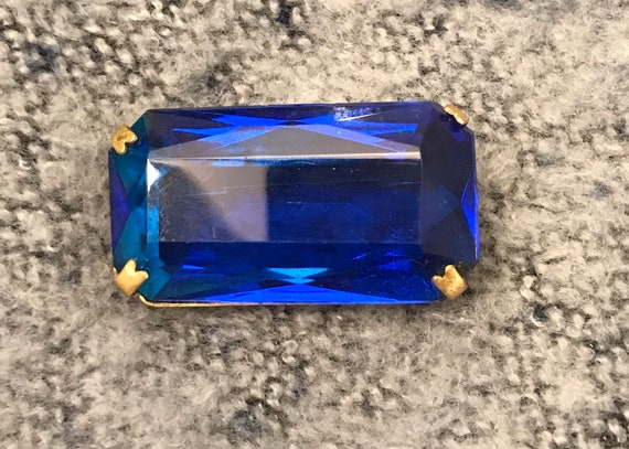 Vintage blue glass cut brooch on a gold metal clasp