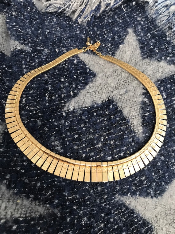 Gold metal necklace made in the 60's
