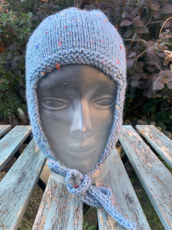 Hand knitted trapper hat with tie up