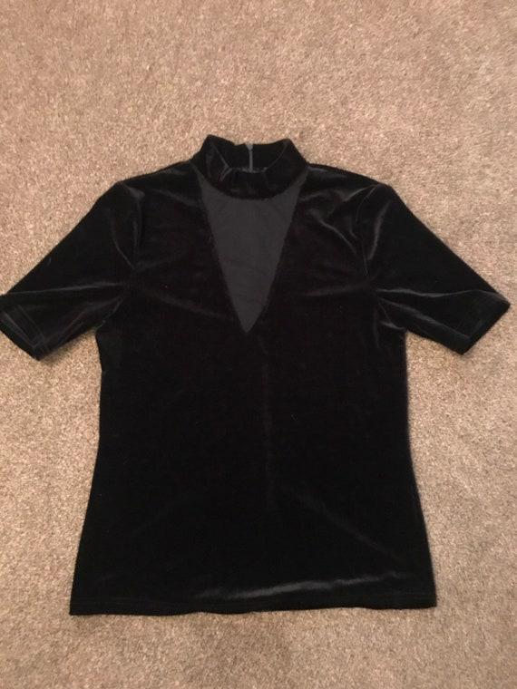 1990's black velvet top with a mesh v on the chest.  size medium