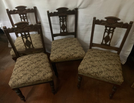 Set of four Edwardian mahogany dining room chairs, with carved backs and turned legs. Buyer to collect or arrange courier from CR04AA