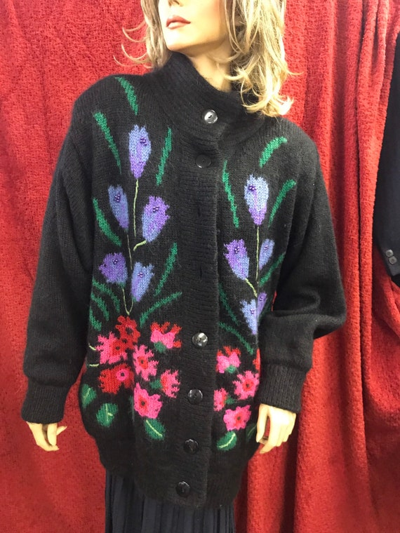 Black cardigan with flowers and beads on the front