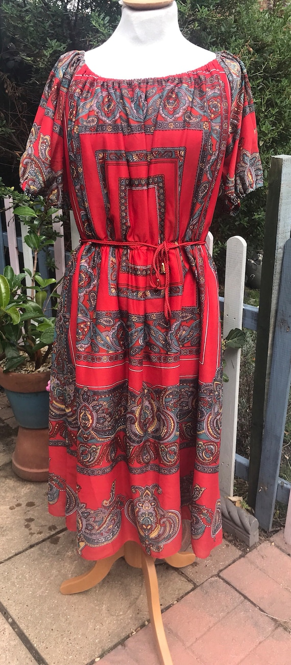 Red vintage patterned dress by Geraldine