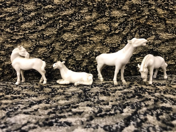 Four vintage minature white porcelain horses