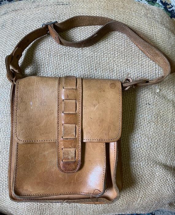 Beautiful tan leather flapover handbag