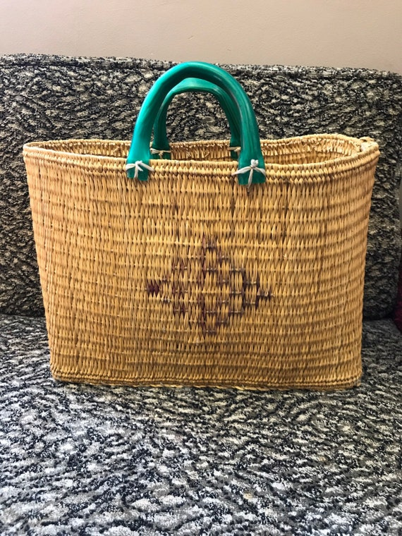Stunning 1940's woven wicker bag with green handles