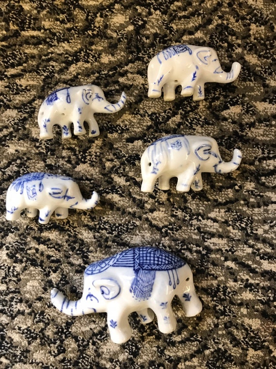 Five vintage minature white and blue  ceramic elephants
