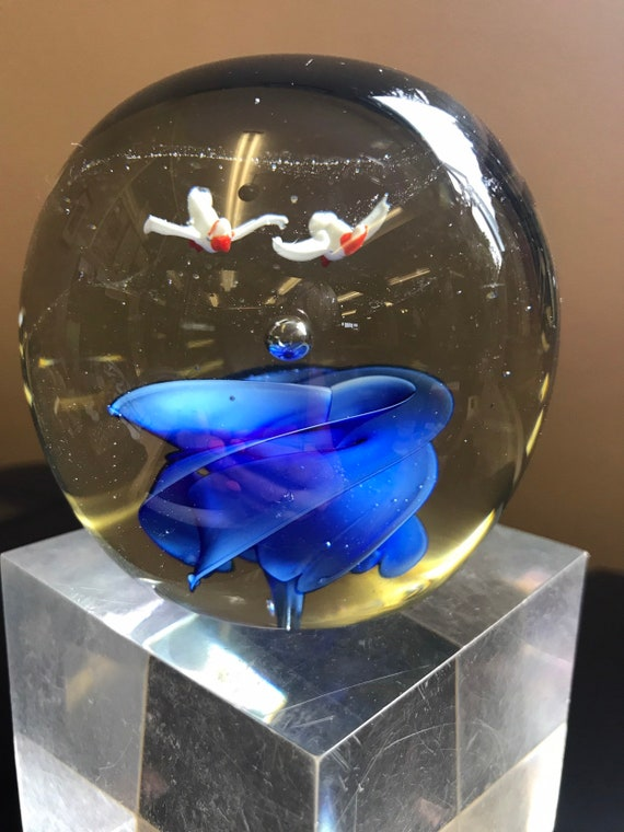 Beautiful  handmade paperweight with two birds flying above a blue flower