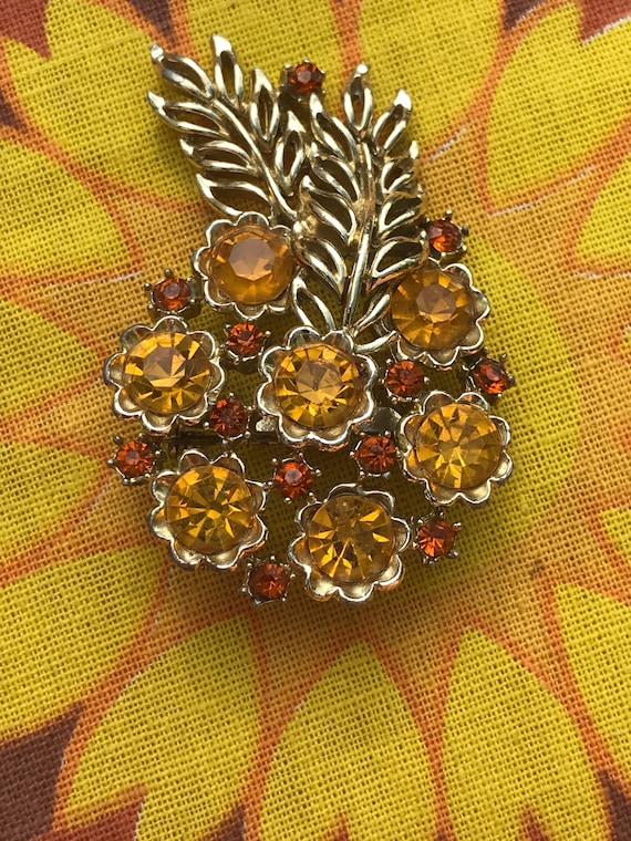 Lovely vintage flower brooch with yellow and orange stones