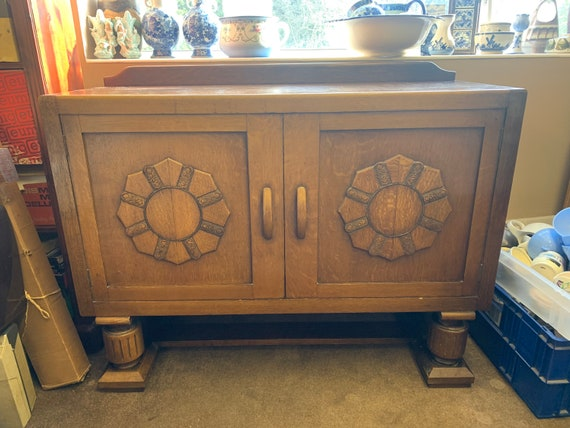1930's oak dining room cabinet/ sideboard. Buyer to collect or arrange courier.